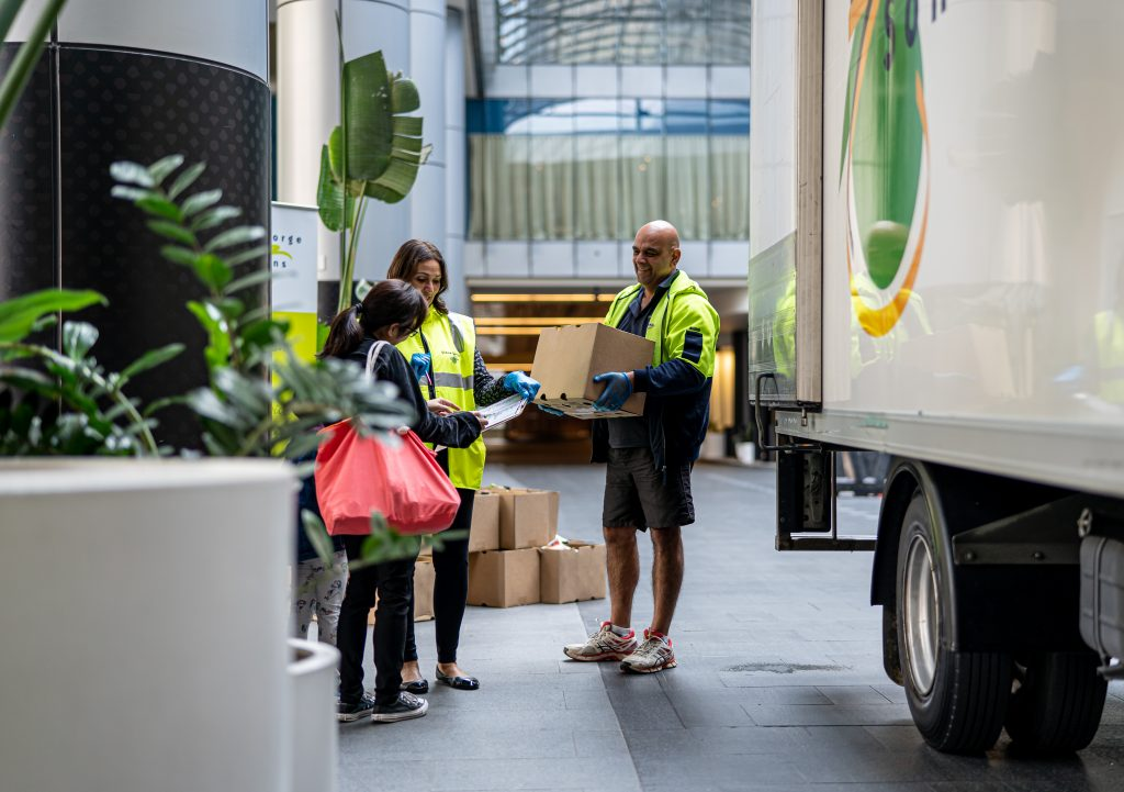 A Simon George & Son driver delivers a care package