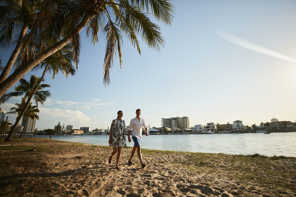 Couple walking on Budds Beach