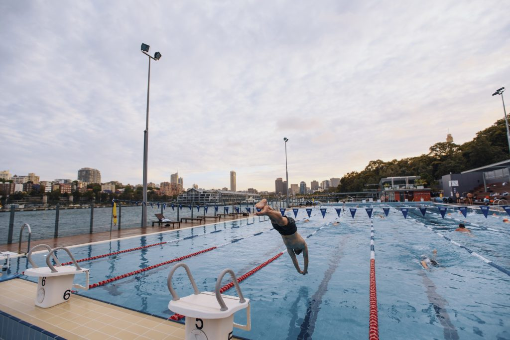A man dives into Andrew Boy Charlton Pool