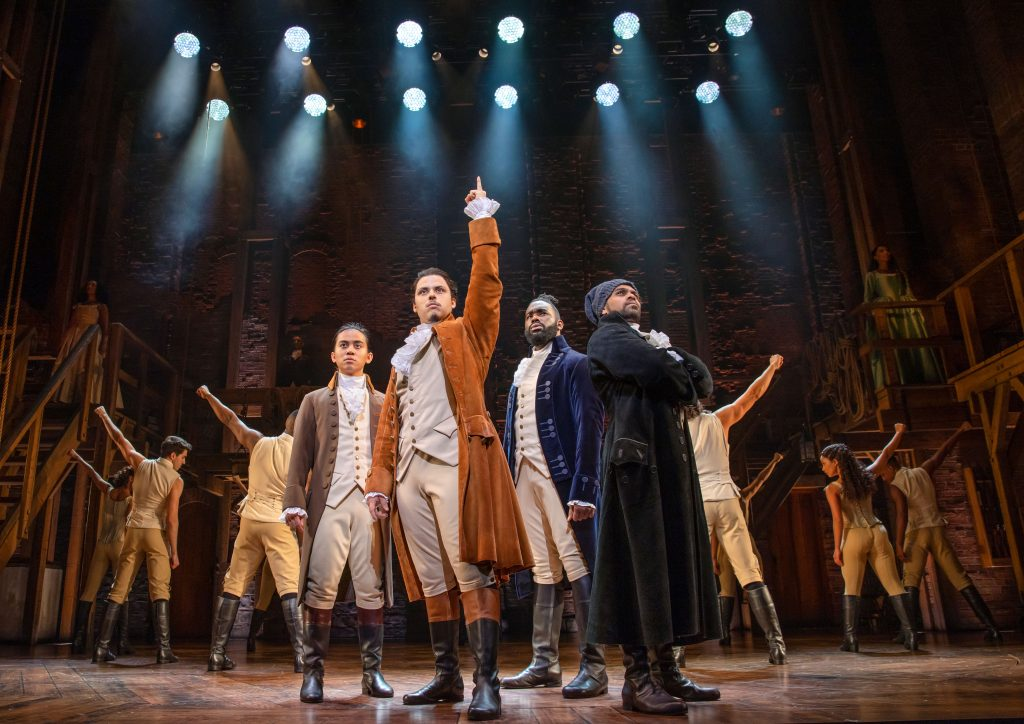 The Australian cast of Hamilton on stage