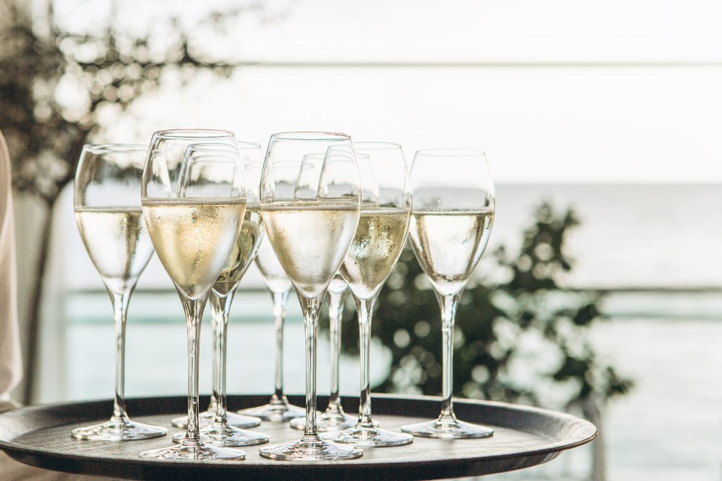 Glasses with champagne or white sparkling wine.