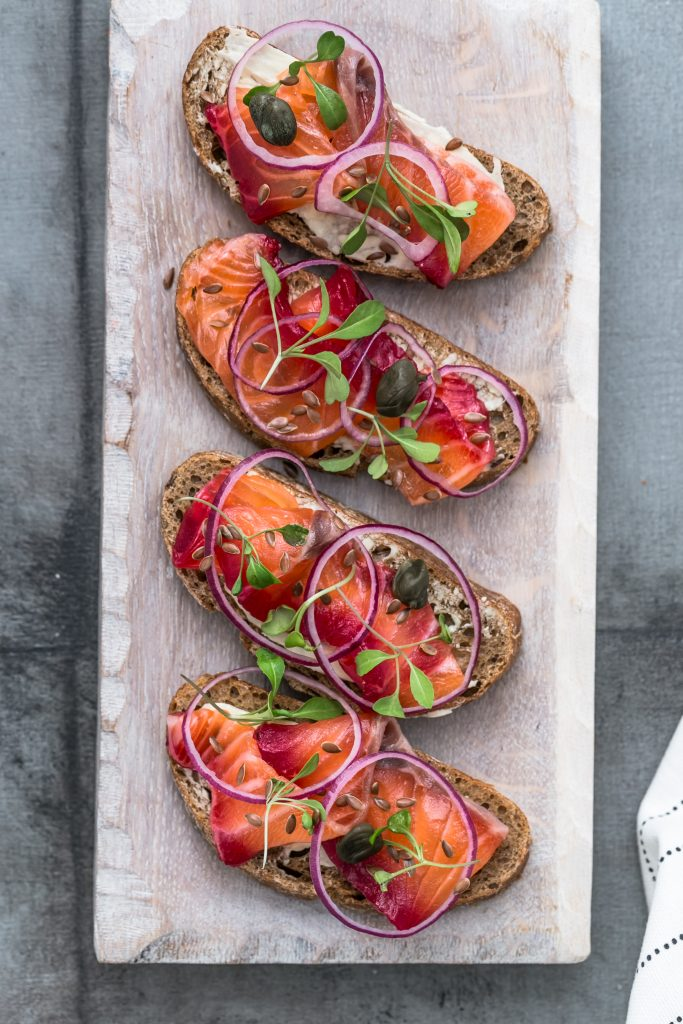 Cured salmon gravlax on a crusty bread.