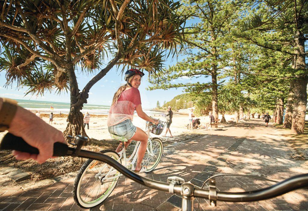 Cycling along Gold Coast Beachfront