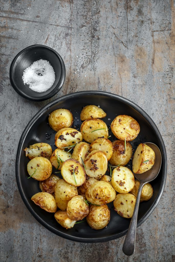 Roasted baby potatoes with mustard and rosemary.