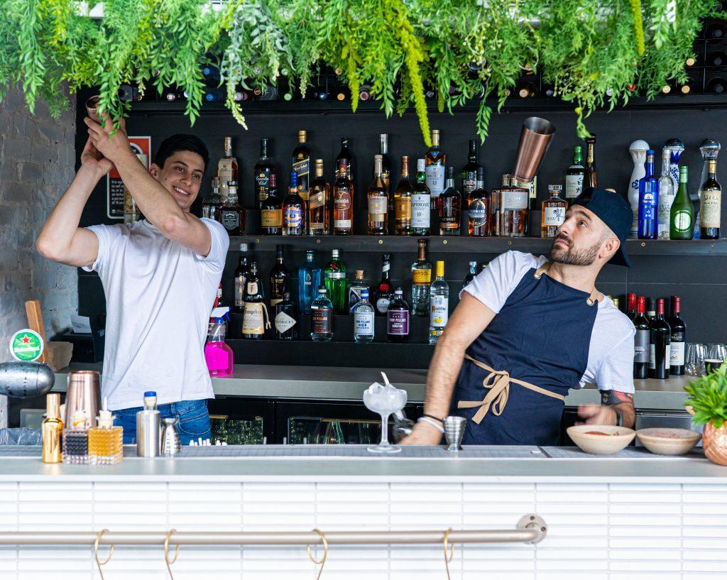 Bartenders preparing drinks at Bar Tikram