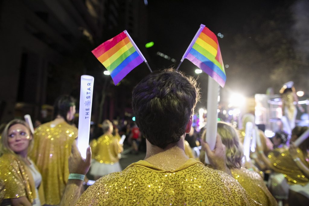 The Star member wears Pride flags at the 2020 Mardi Gras parade