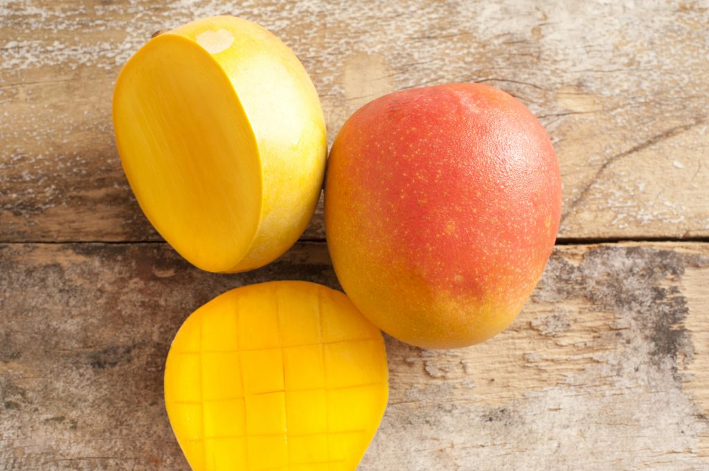 Fresh mangoes sliced on a table